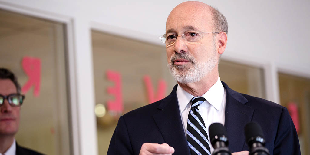 Image of Governor Tom Wolf speaking next to a set of windows.