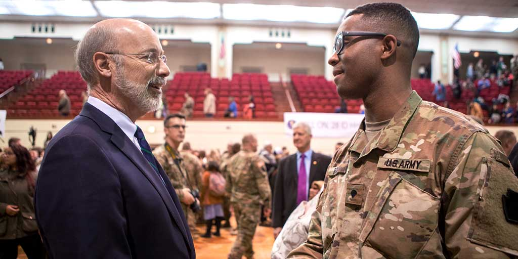 Image of Governor Tom Wolf speaking to a member of the Pennsylvania National Guard.