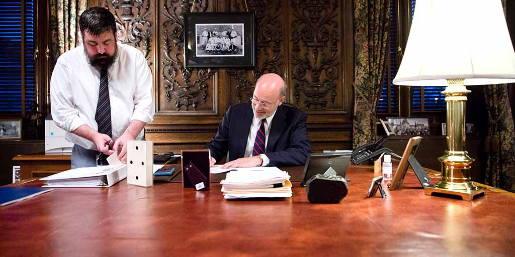 Image of Governor Tom Wolf signing the budget.