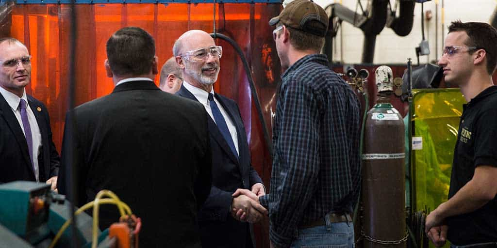 Image of Governor Tom Wolf shaking hands with someone.