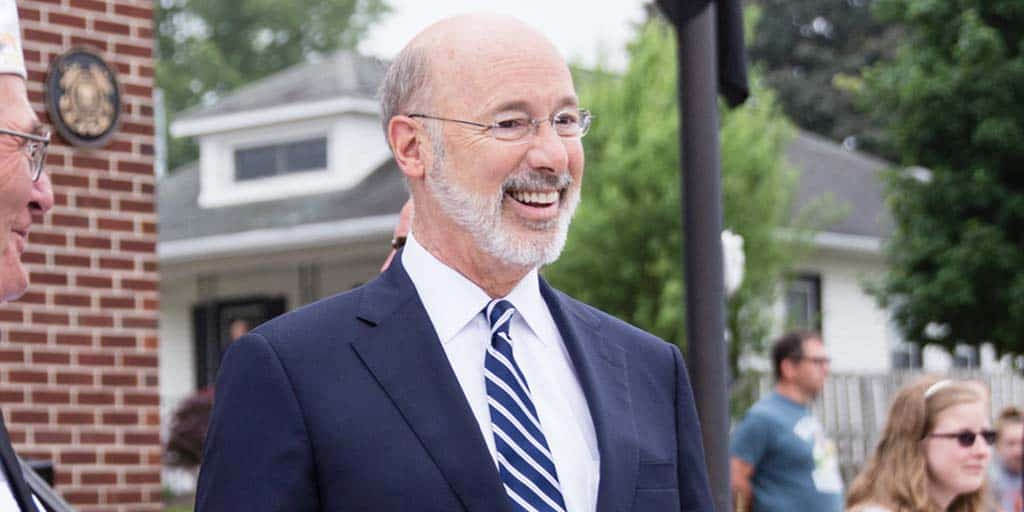 Image of Governor Tom Wolf smiling outdoors.