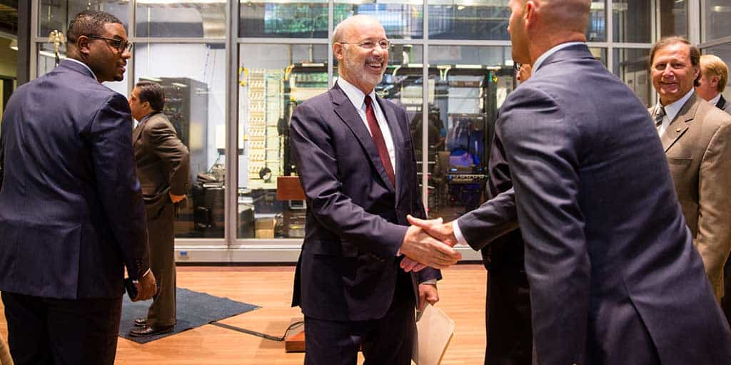 Image of Governor Tom Wolf shaking hands with event participants.