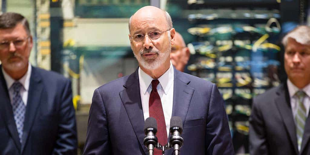 Image of Governor Tom Wolf speaking in front of computer servers.