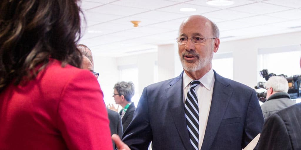 Image of Governor Tom Wolf speaking to a community leader