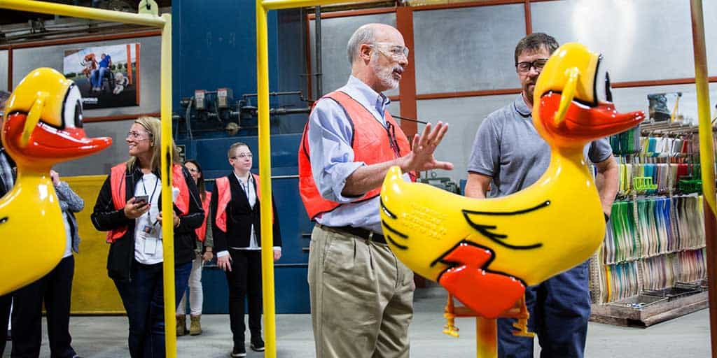 Image of Governor Tom Wolf inspecting a recently manufactured apparatus.