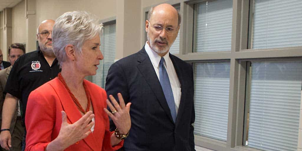 Image of Governor Tom Wolf walking down a hall at a Center of Excellence.