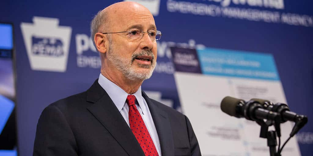 Image of Governor Tom Wolf speaking from behind a podium at PEMA.