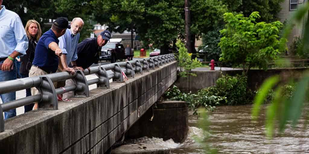 Image of Governor Tom Wolf inspecting a river.
