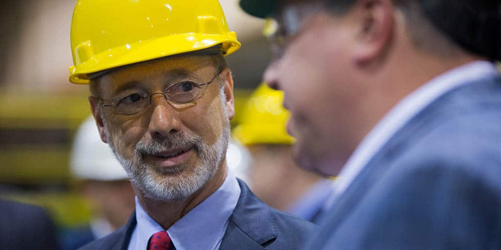 Close up image of Governor Tom Wolf speaking to someone.
