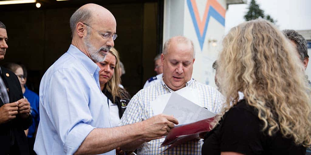 Image of Governor Tom Wolf inspecting documents.
