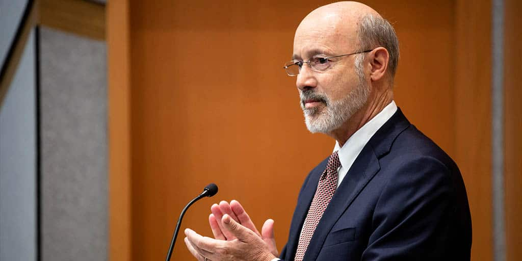 Image of Governor Tom Wolf applauding.