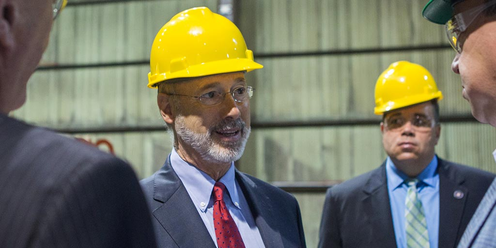 Image of Governor Tom Wolf wearing a hard hat.