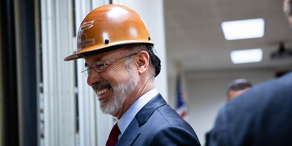 Image of Governor Tom Wolf wearing a hardhat.