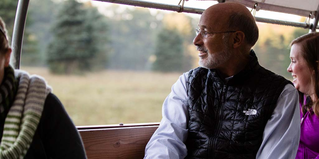 Image of Governor Tom Wolf overlooking a grass field.