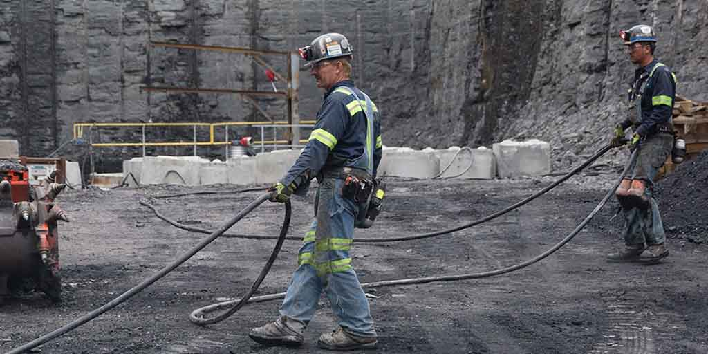 Image of coal miners at work.
