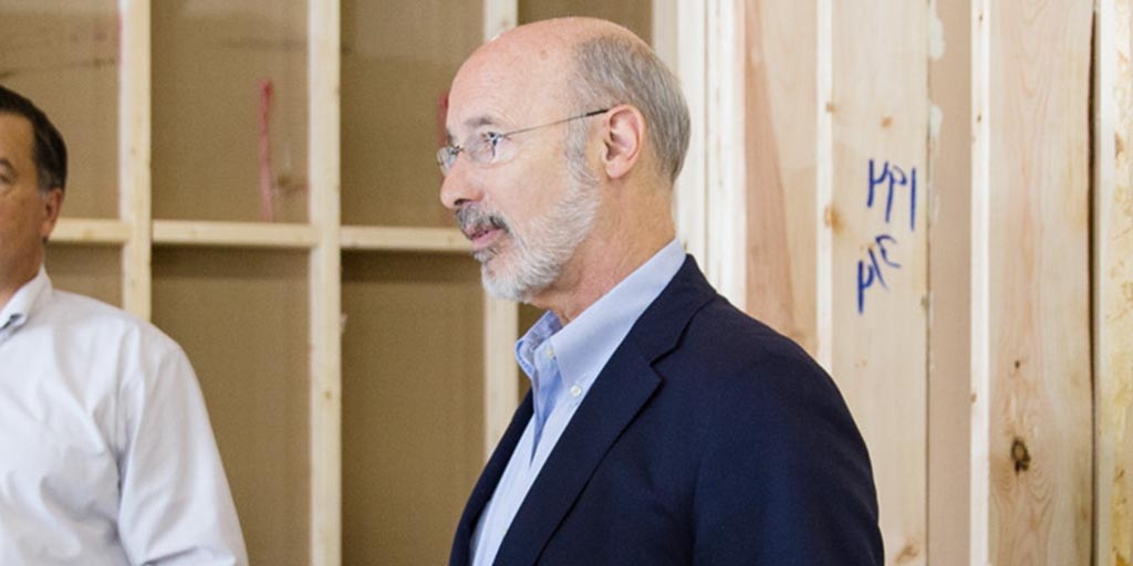 Image of Governor Tom Wolf in a house under construction.