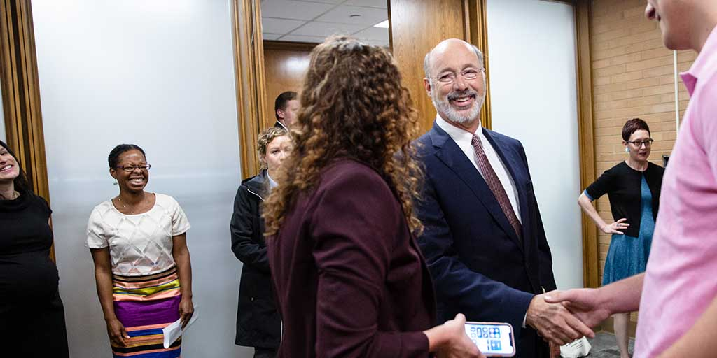 Image of Governor Tom Wolf greeting people in a room.