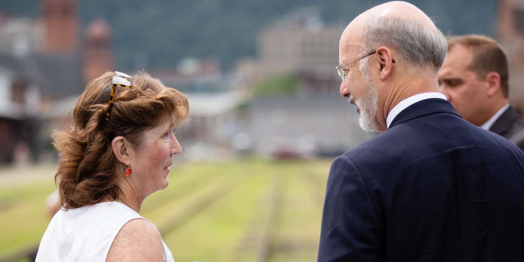 Image of Governor Tom Wolf looking over a site.