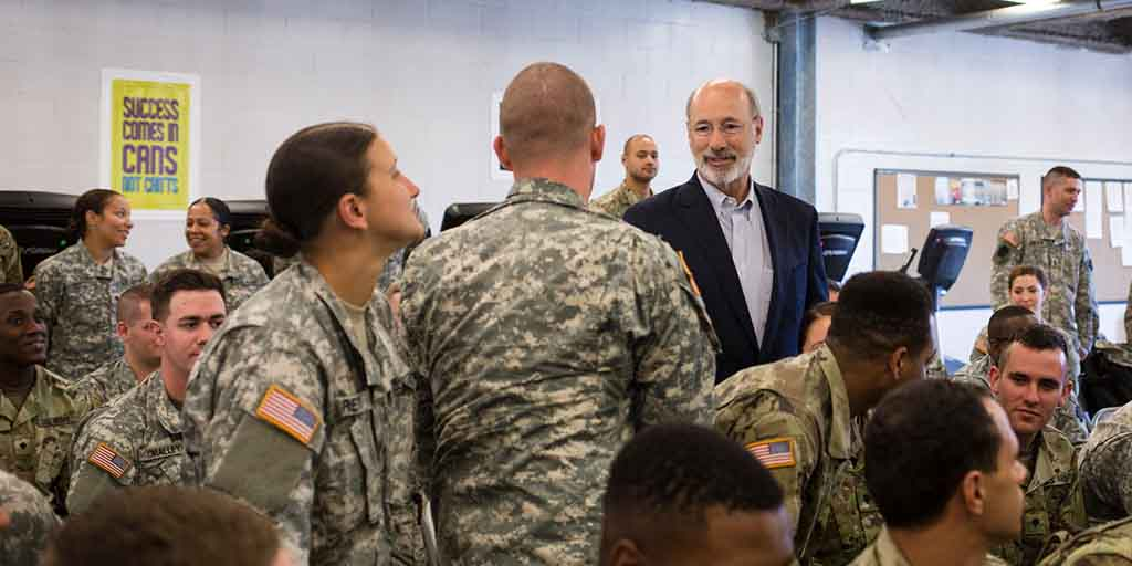 Image of Governor Tom Wolf shaking hands with members of the National Guard.