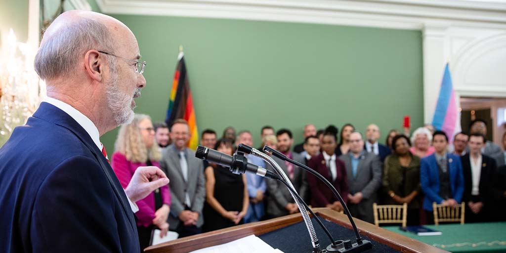 Image of Governor Tom Wolf and the Commission on LGBTQ Affairs.