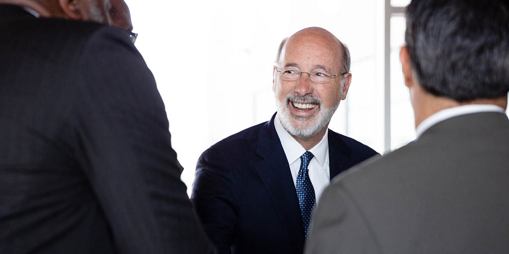 Image of Governor Tom Wolf shaking hands with people.