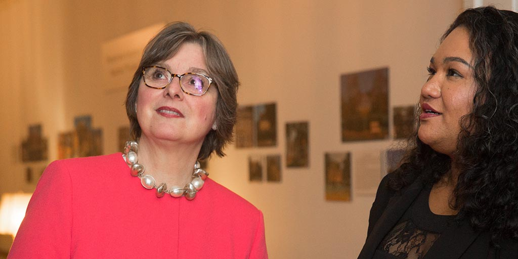 Image of First Lady Frances Wolf with a person gazing at an art installation.