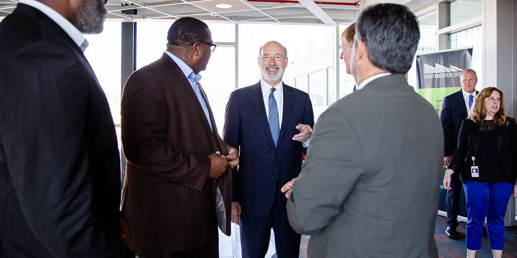 Image of Governor Tom Wolf talking to a group of people.