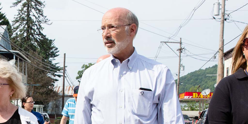 Image of Governor Tom Wolf walking down a street.