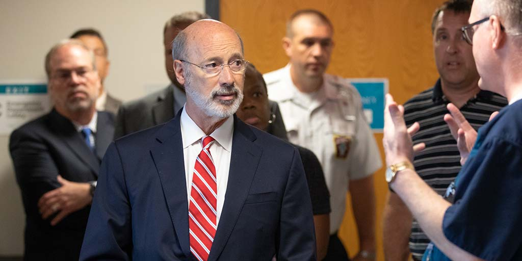 Image of Governor Tom Wolf speaking to a health care provider.