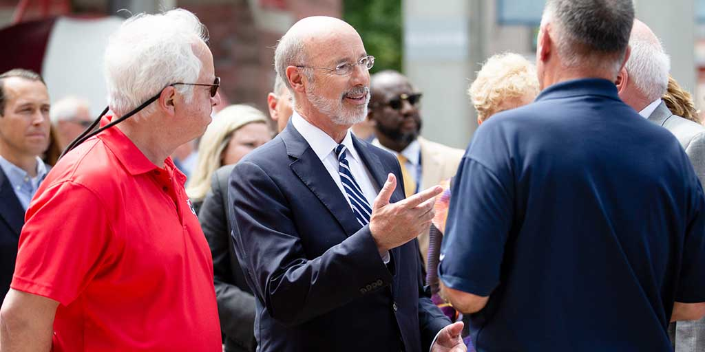 Image of Governor Tom Wolf speaking to people outside.