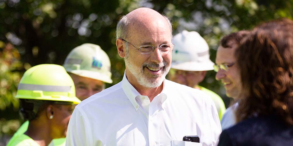 Image fo Governor Tom Wolf standing outside and smiling.