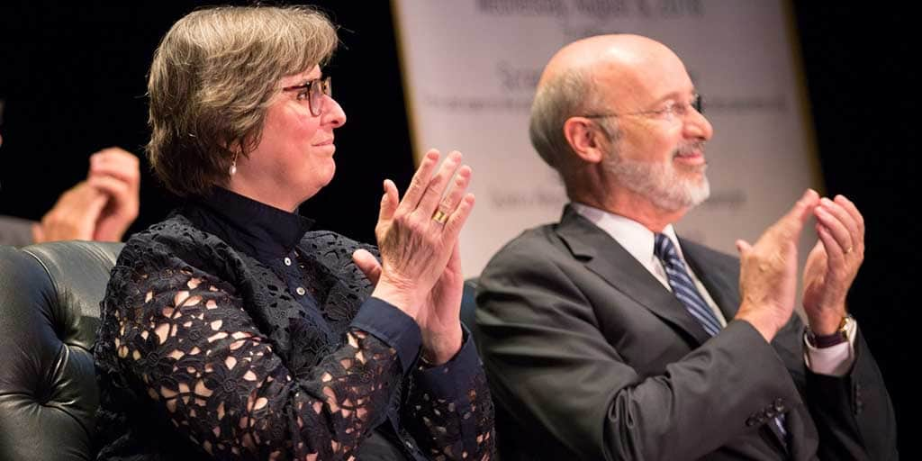 Image of Governor Tom Wolf and First Lady Frances Wolf applauding.