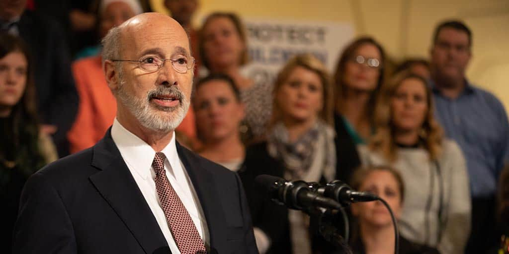Image of Governor Tom Wolf standing with advocates.