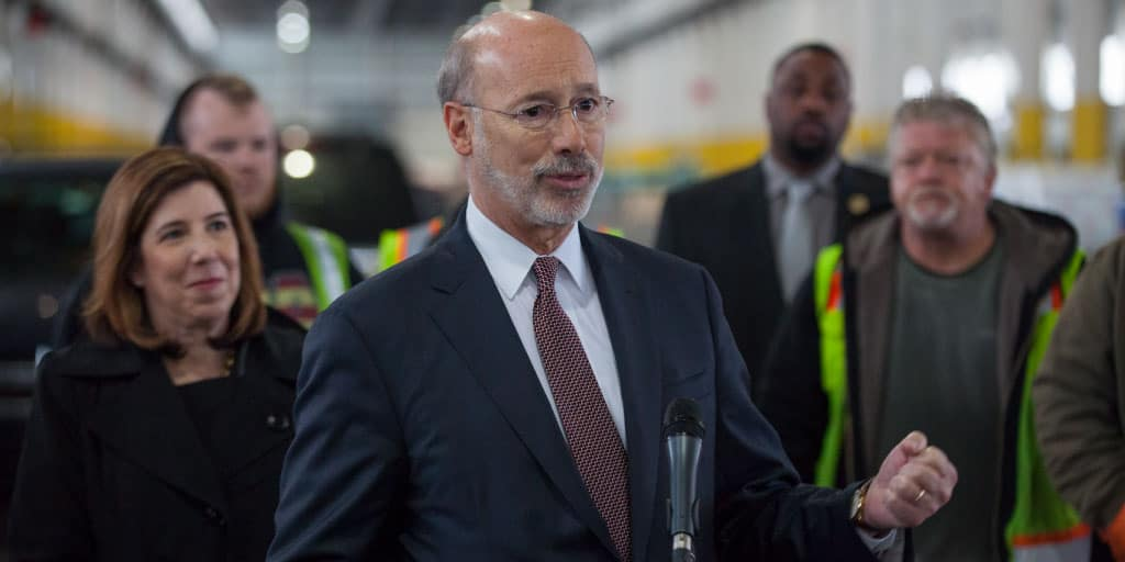 Image of Governor Tom Wolf speaking at a port facility.