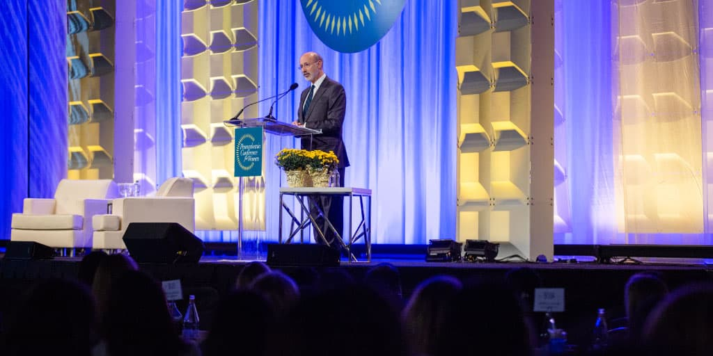 Image of Governor Tom Wolf speaking on a large stage.