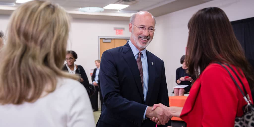 Image of Governor Tom Wolf shanking hands with someone.