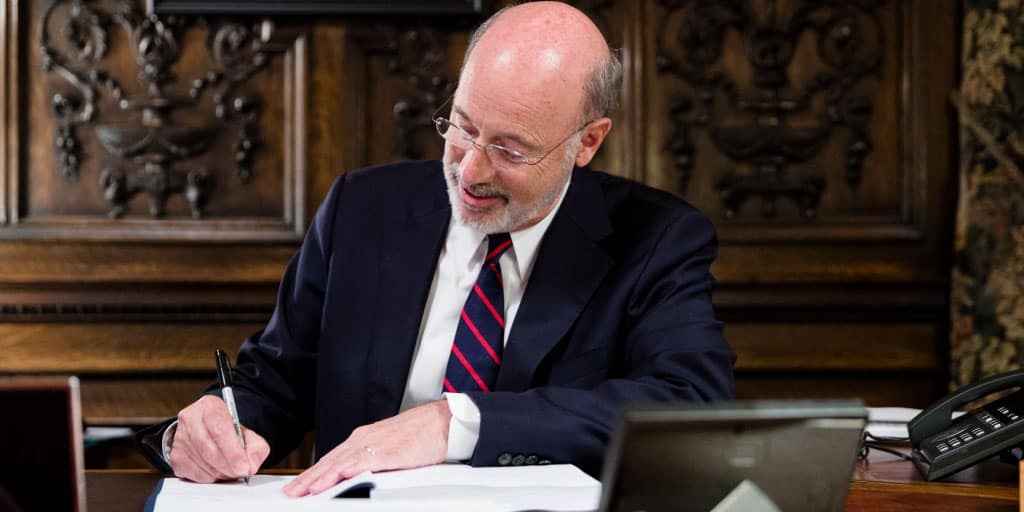 Image of Governor Tom Wolf signing a bill.