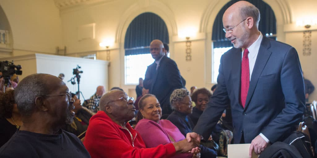 Image of Governor Tom Wolf shaking hands with a senior.