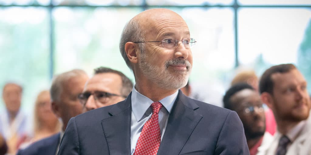 Image of Governor Tom Wolf looking back and smiling.