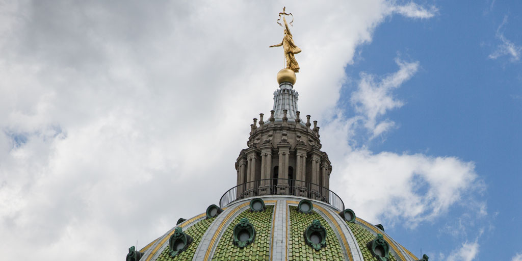 Image of the Lady Commonwealth on the top of the PA State Capitol