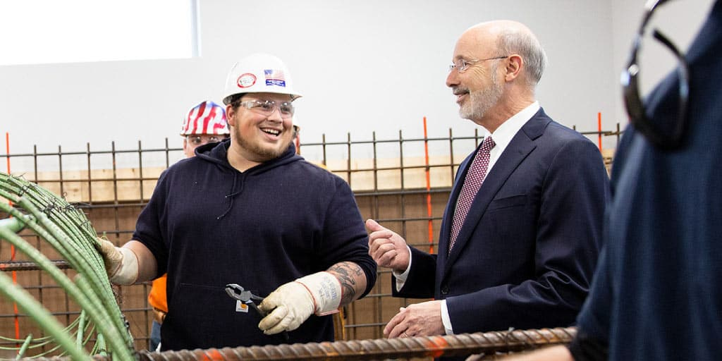 Governor Tom Wolf talking with a worker.