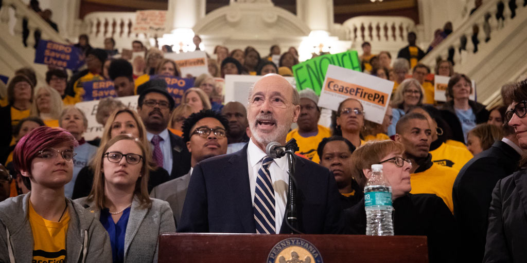 Governor Tom Wolf speaking in front of advocates at a CeaseFirePA rally in the Capitol Rotunda.
