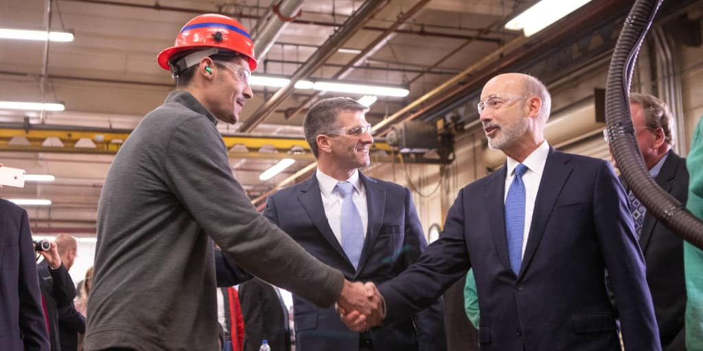 Governor Tom Wolf shaking hands with a worker at Steel High Structures in Lancaster County.