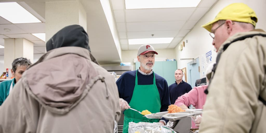 Governor Tom Wolf serving food to the homeless.