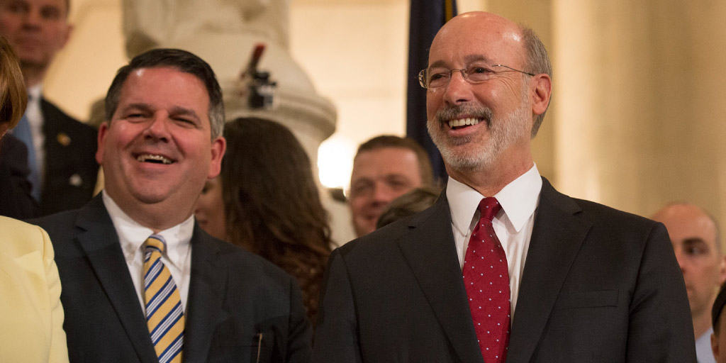 Governor Tom Wolf smiling at a medical marijuana event in the capitol.