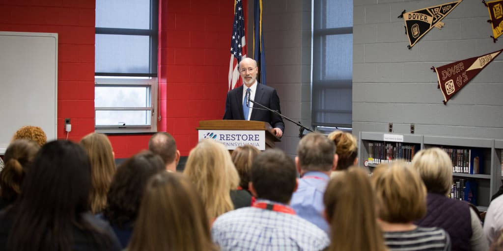 Governor Tom Wolf speaking to a group of single parents about higher education.