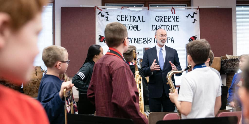 Governor Wolf speaking to a classroom of student musicians in Waynesburg.
