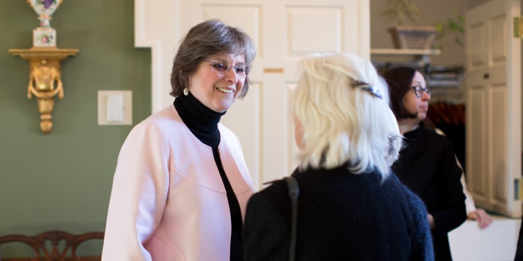 First Lady Frances Wolf speaking with a woman.