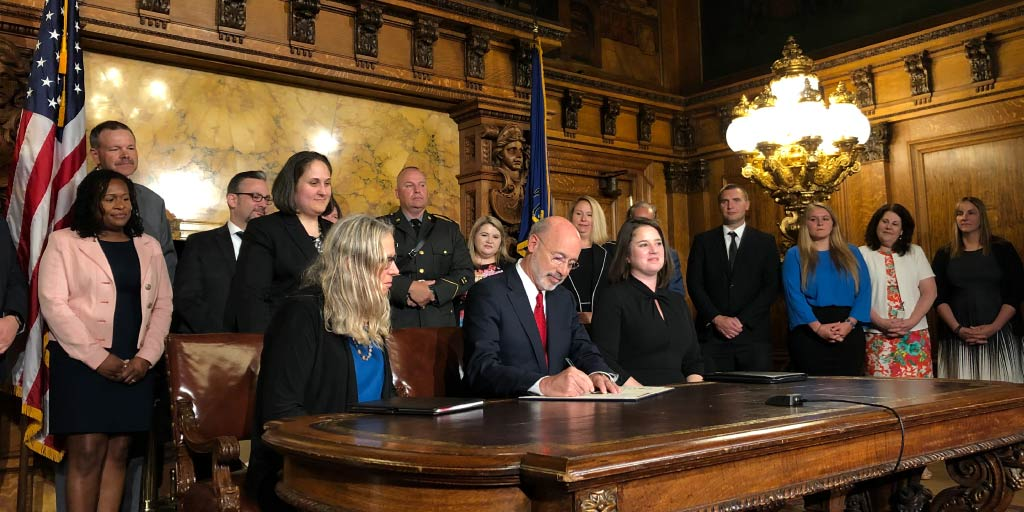 Governor Tom Wolf signing an opioid renewal.