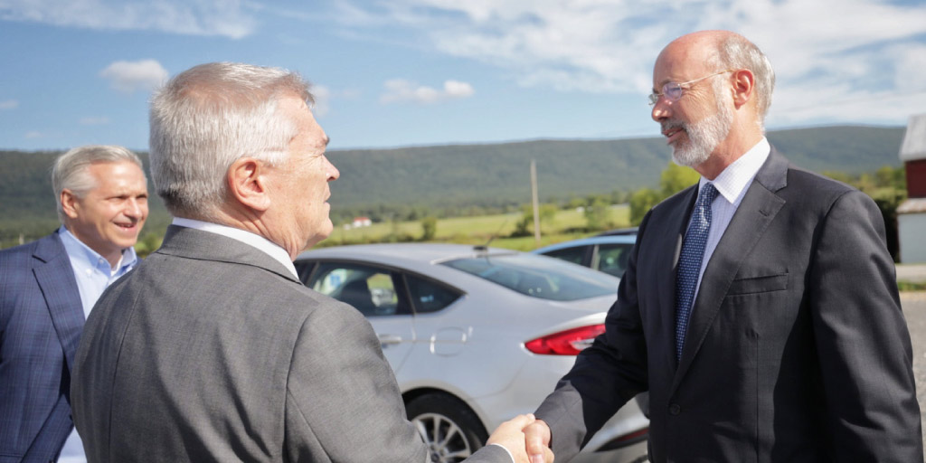 Governor Wolf shaking a man's hand.